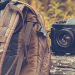 Lifestyle hiking camping equipment retro photo camera backpack a